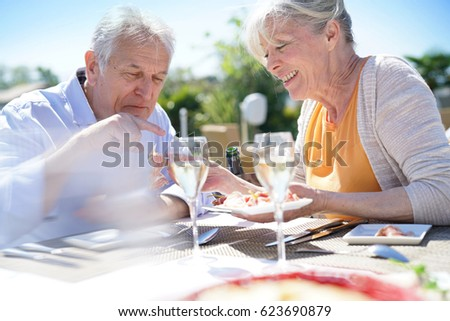 Senior couple enjoying meal in outdoor restaurant #623690879