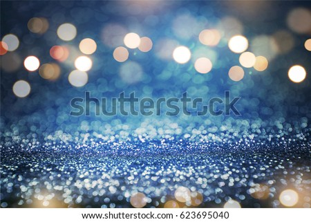 Blue glitter and gold lights bokeh abstract background. defocused, holiday concept Royalty-Free Stock Photo #623695040