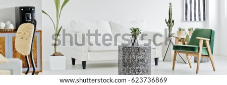Modern white living room with sofa, chair, table and plants #623736869