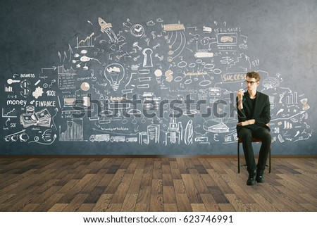 Thoughtful young businessman sitting on chair in interior with business sketch on wall. Brainstorm concept. 3D Rendering #623746991