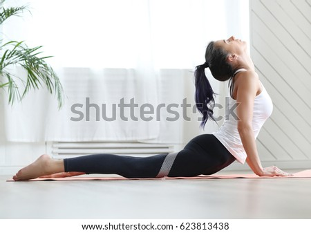 Lifestyle. Young woman practicing yoga #623813438