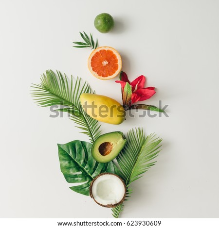 Creative layout made of summer tropical fruits and leaves. Flat lay. Food concept. #623930609