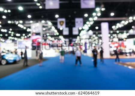 Abstract blur and defocused car and motor exhibition show interior for background #624064619