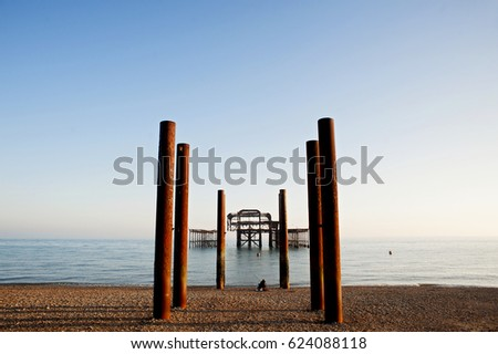 The West Pier, Brighton, England, 2017. A solitary fisherman at Brighton's West Pier, is a famous landmark on the south coast of England, now a burnt-out rusting skeleton due to 2 fires in 2003 #624088118