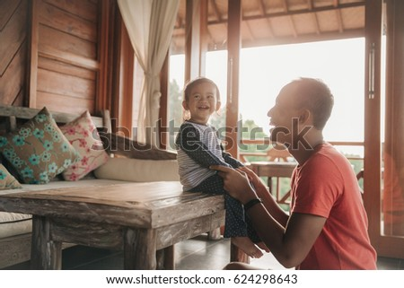 portrait of father and daughter enjoying family time together #624298643