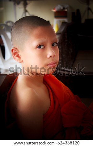 novice in thailand, young monk at temple. #624368120
