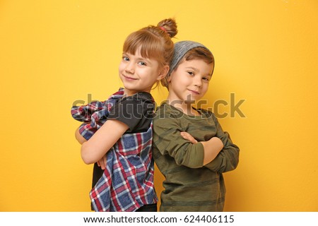 Cute stylish children on color background Royalty-Free Stock Photo #624406115