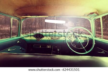 Vintage car on road in forest  #624431501
