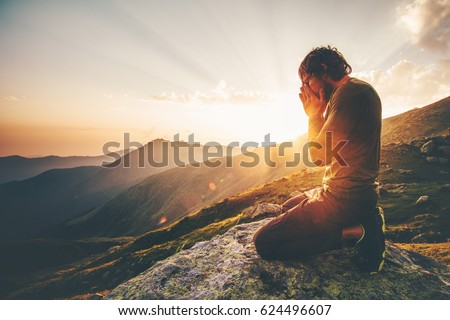 Man praying at sunset mountains Travel Lifestyle spiritual relaxation emotional meditating concept vacations outdoor harmony with nature landscape Royalty-Free Stock Photo #624496607