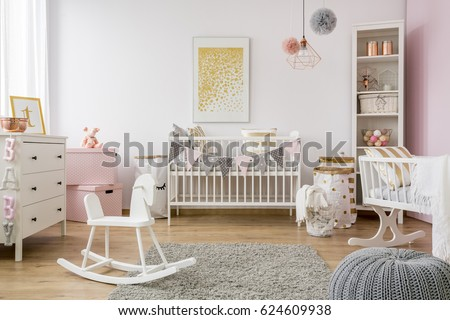 Baby room in scandinavian style with rocking horse, white cot Royalty-Free Stock Photo #624609938