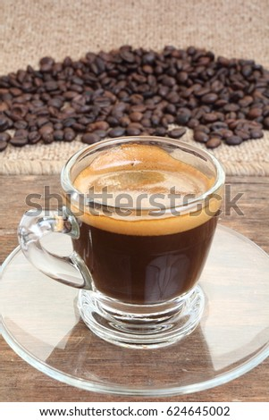 Coffee cup and coffee beans on wooden background #624645002