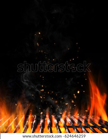 Empty flaming charcoal grill with open fire, ready for product placement. Concept of summer grilling, barbecue, bbq and party. Black copyspace Royalty-Free Stock Photo #624646259