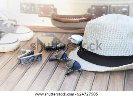 straw hat, sunglasses, phone shoes and suitcase on wooden background  #624727505