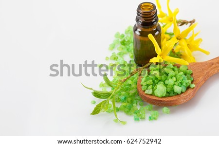Essential oil for aromatherapy and sea salt in wooden spoon #624752942