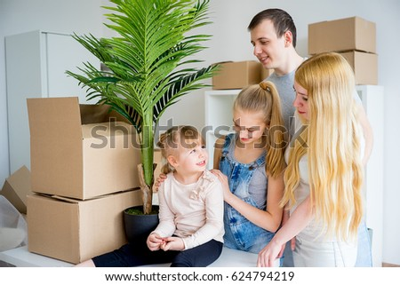Family moving into new home #624794219