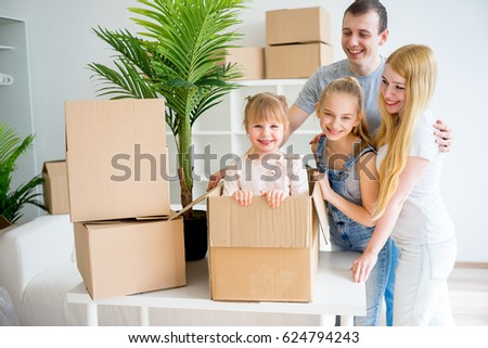 Family moving into new home #624794243