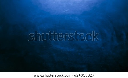 Abstract Chalk rubbed out on blue board for background. texture for add text or graphic design. Education concept. abstract dark blue texture for background.