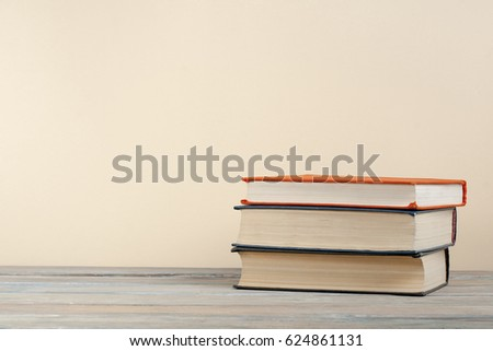 Stack of books on wooden table. Copy space for text. Back to school. Education concept. #624861131