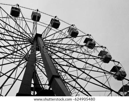 Ferris wheel in Bulvar (Deniz Kenari Milli Park) Baku, Azerbaijan. Under view of ferris wheel for background and abstract compositions. Royalty-Free Stock Photo #624905480