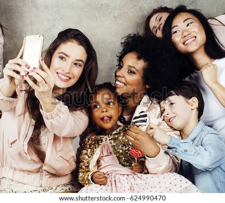 Lifestyle and people concept: young pretty diversity nations woman with different age children celebrating on birth day party together happy smiling, making selfie. African-american, asian and #624990470