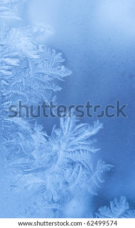 Fairy-like sparkling winter background (slightly blurred frostwork on a window glass) Royalty-Free Stock Photo #62499574