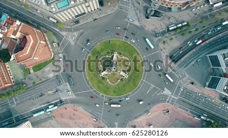 Aerial shot of Plaza de Espana in Barcelona, Spain. Roundabout city traffic, top view Royalty-Free Stock Photo #625280126