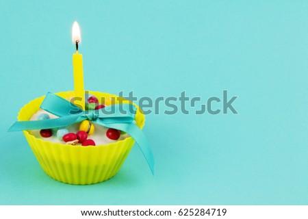 Vanilla Cupcake for Birthday on Blue Background. #625284719