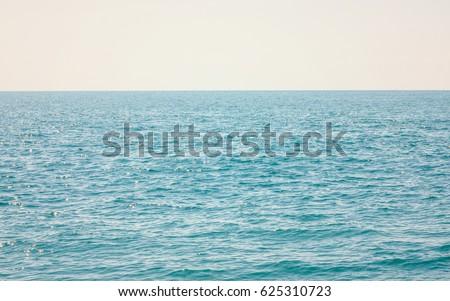 Sea horizon on a Sunny day #625310723