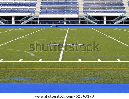 Sports stadium with football field and track #62549170
