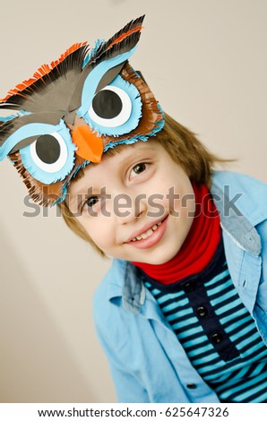 child with an owl mask #625647326