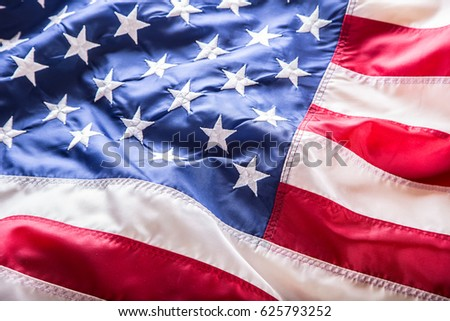 American flag waving in the wind. #625793252