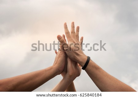 Hands hit and join together in to sky,after everybody success something that they do, example win in game,success in business,market up volume sales.symbolizing to trust each other.  Royalty-Free Stock Photo #625840184