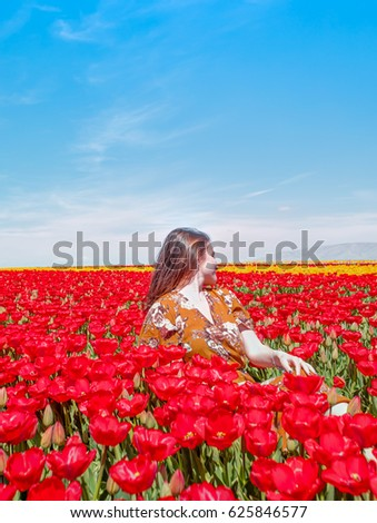 young attractive girl in tulip field #625846577