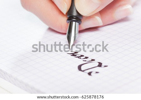 Hand writing with fountain pen on squared notebook #625878176