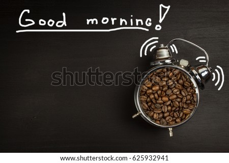 Retro alarm clock with coffee beans. Morning coffee after waking up. Wake up