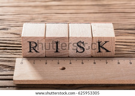 Risk Word On Blocks Arranged Behind The Ruler On Wooden Table Royalty-Free Stock Photo #625953305