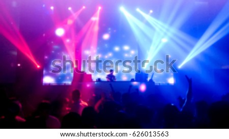 DJ turns  music people dancing in night club   photo blur #626013563