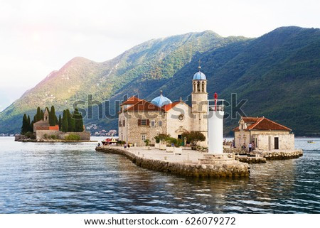 Fjord in Adriatic Sea. Our Lady of the Rock island and Church in Perast on shore of Boka Kotor bay (Boka Kotorska), Montenegro, Europe. Kotor Bay is a UNESCO World Heritage Site #626079272