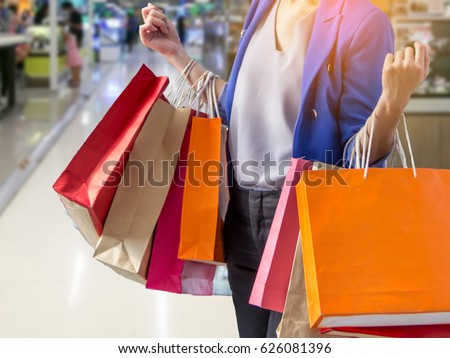 woman holding shopping bag in mall  #626081396