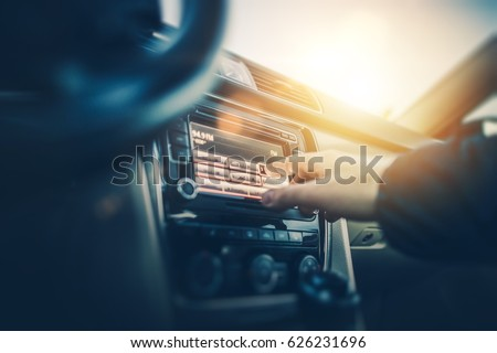 Car Radio Listening. Car Driver Changing Radio Stations on His Vehicle Multimedia System. Modern Touchscreen Audio System. #626231696