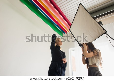 Girl photographer photographing model #626249297