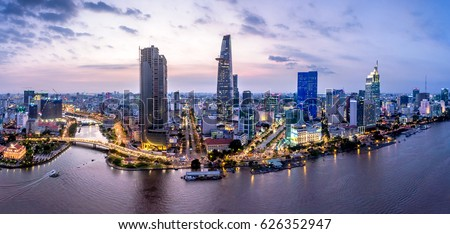Top view aerial photo from flying drone of a Ho Chi Minh City with development buildings, transportation, energy power infrastructure. Financial and business centers in developed Vietnam. #626352947