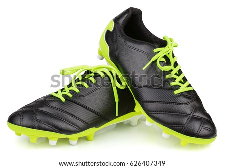 Pair of new unbranded black leather football shoes or soccer boots isolated on white background with clipping path #626407349