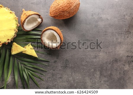 Pineapple and coconut on gray background #626424509