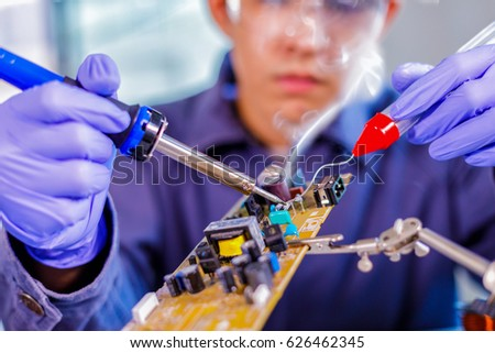 Engineer or technician repair electronic circuit board with soldering iron #626462345