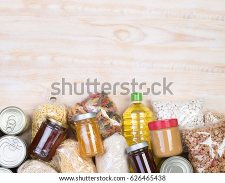 Food donations on wooden background, top view with copy space #626465438