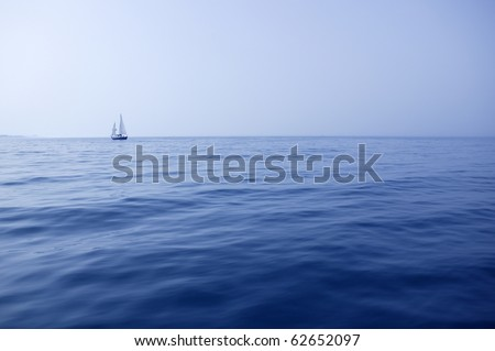 Blue sea with sailboat sailing the ocean surface summer vacation #62652097