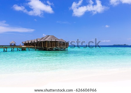 Tropical travel card with pristine beach and water bungalows at maldivian island. #626606966