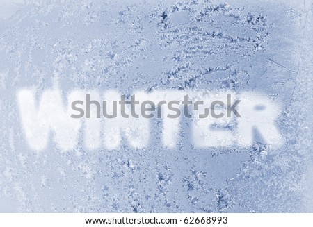 Word winter on the frozen window. Royalty-Free Stock Photo #62668993