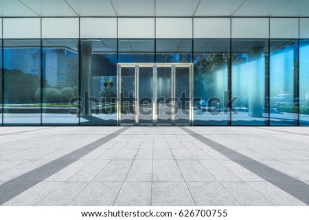 empty pavement front of office entrance  Royalty-Free Stock Photo #626700755